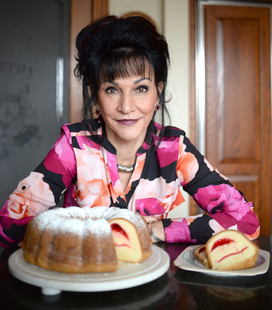 Rosemarie Aquilina, 30th Circuit Court Judge, bakes fruit filled pound cake with powdered sugar, in her kitchen in East Lansing, MI. Sunday, February 3, 2019. (Photo by Viviana Pernot)