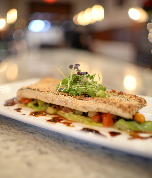 Sesame crusted local Indian Brut Trout with ratatouille and cabbage.