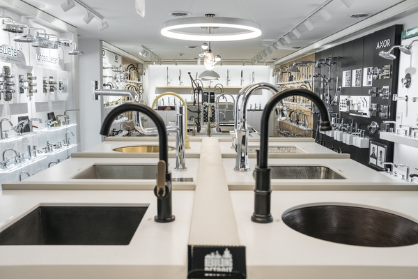 Faucets and sinks sit on display at Advance Plumbing and Heating Supply Company's Detroit showroom.