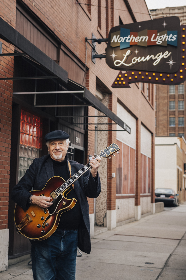 Guitarist Dennis Coffey outside Northern Lights Lounge on Baltimore Street in the New Center neighborhood.