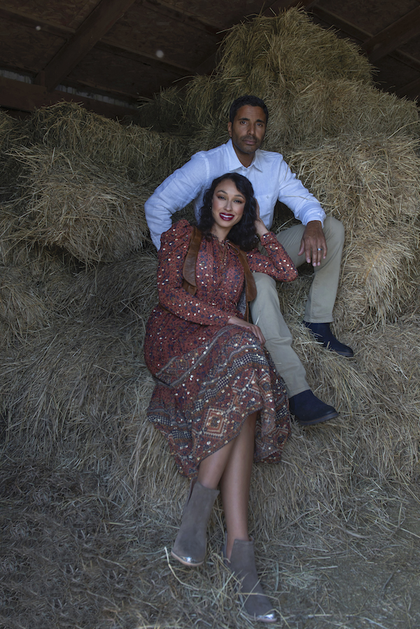 girl and guy sitting on a pile of hay