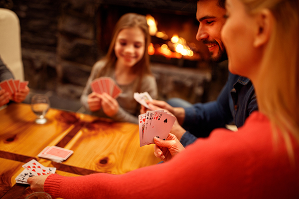 People playing card game at home