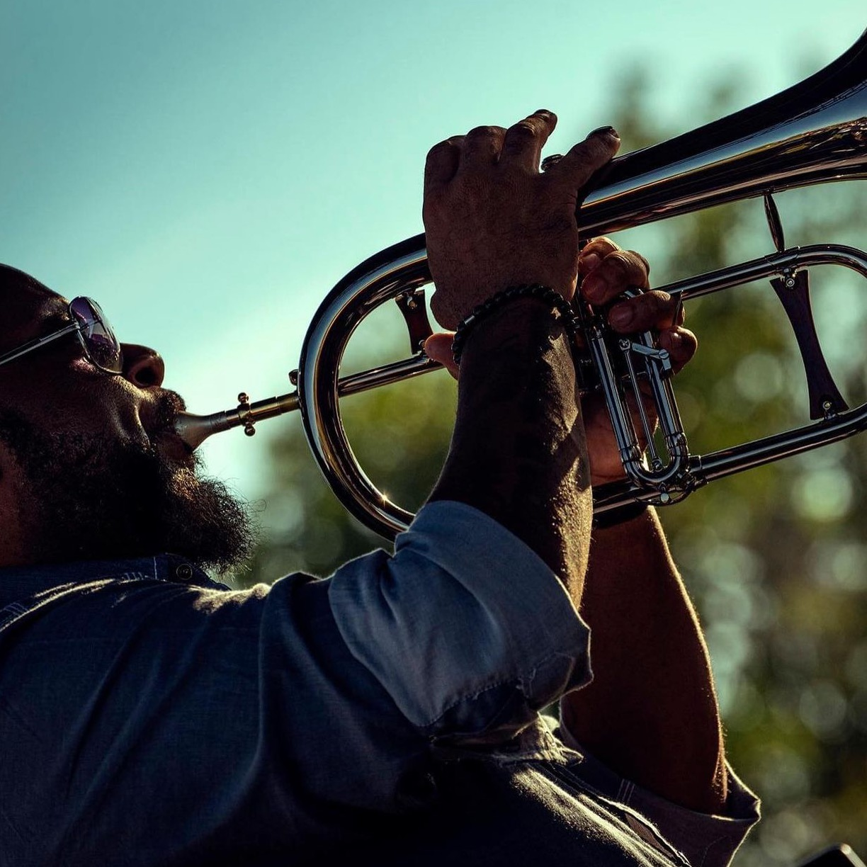 guy playing horn