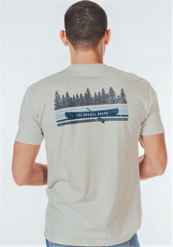 Boat on lake graphic on back of shirt