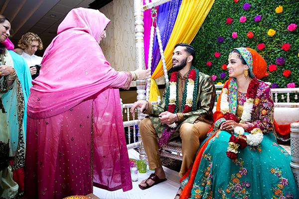 Zaid and Reham receive blessings at the mehndi