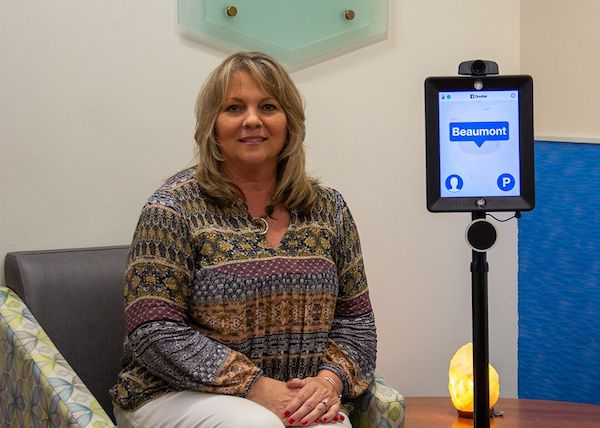 Janis Traynor with Beaumont Student Robot